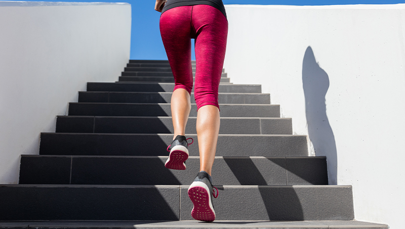 Woman running up stairs for cardio workout