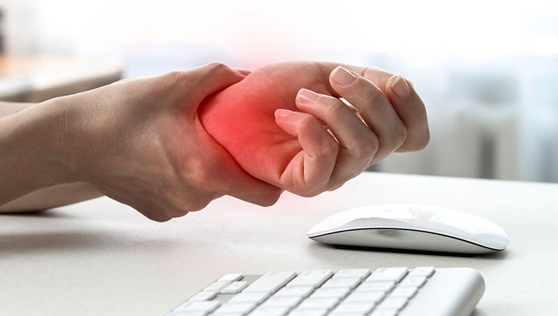 Patient suffering from carpal tunnel syndrome due to typing