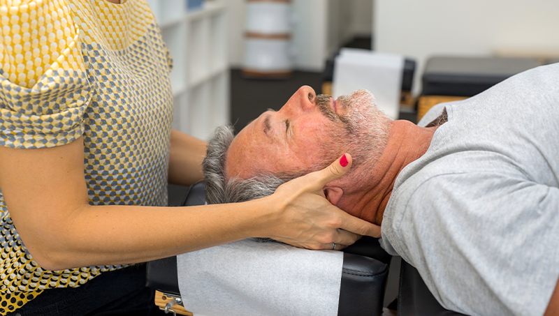 Man receiving chiropractic adjustment for immunity boost