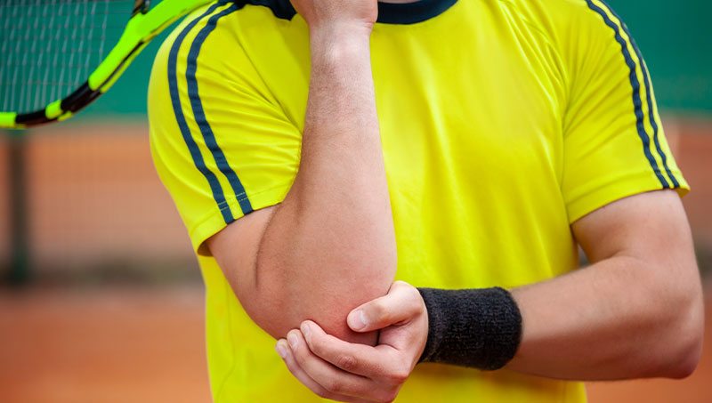tennis player in pain from elbow injury