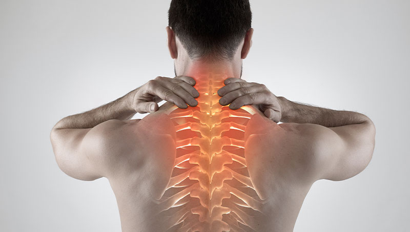 Upper back pain highlighted on man