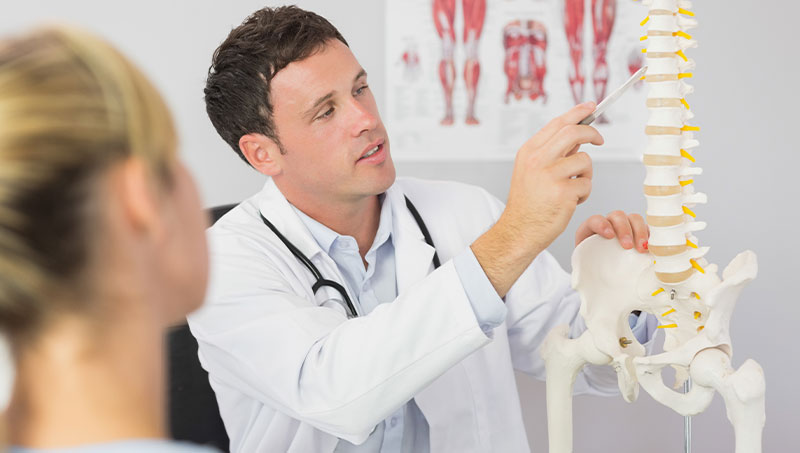 Chiropractor explaining spine health to patient